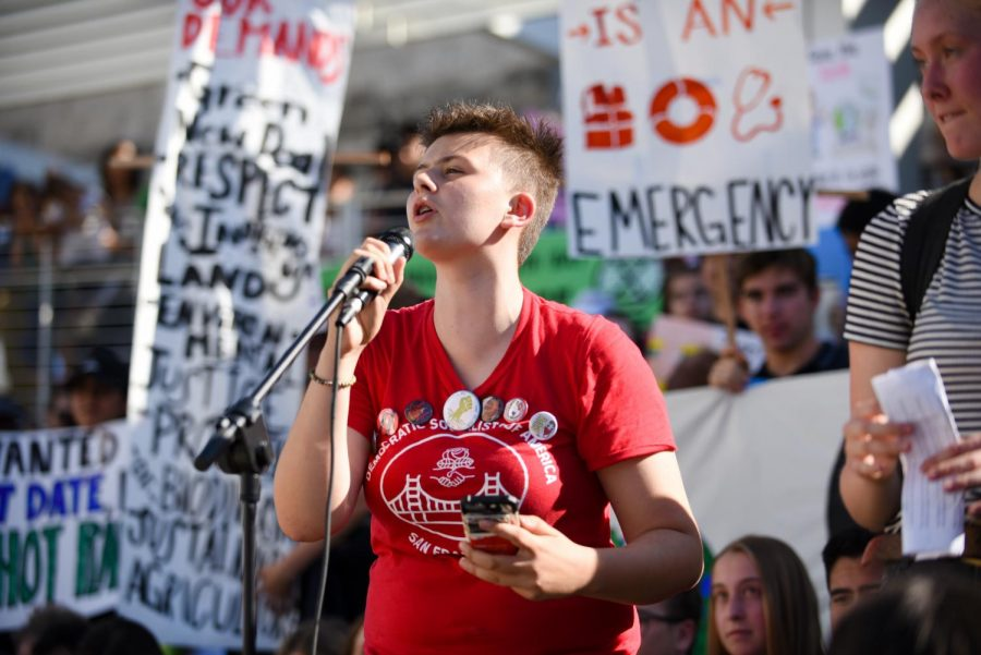 A+student+speaker+wearing+a+%22Democratic+Socialists+of+America%22+tee+deems+capitalism+a+threat+to+the+environmental+situation+at+Friday%27s+climate+strike+rally.