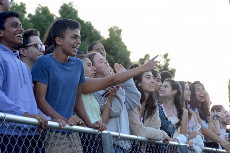 A group of juniors cheer at the varsity football game against Burton. The team next plays against Washington High this Friday, Sept. 6, on Davis Field.