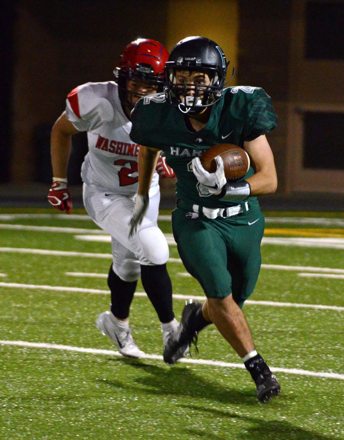 Runningback+Devin+Keller+%2812%29+rushes+during+the+third+quarter.+Devin+scored+Harker%27s+first+points+of+the+game+when+he+ran+for+a+30-yard+touchdown+in+the+second+quarter.+