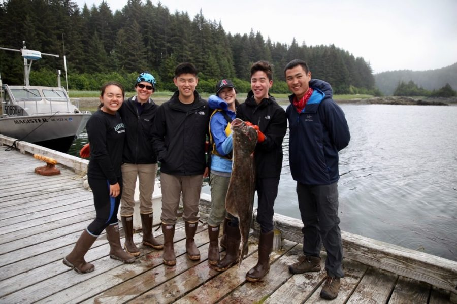 Student%27s+on+the+Alaska+trip+smile+after+an+afternoon+fishing+trip+in+which+they+learned+more+about+the+region%27s+ecology+and+wildlife.