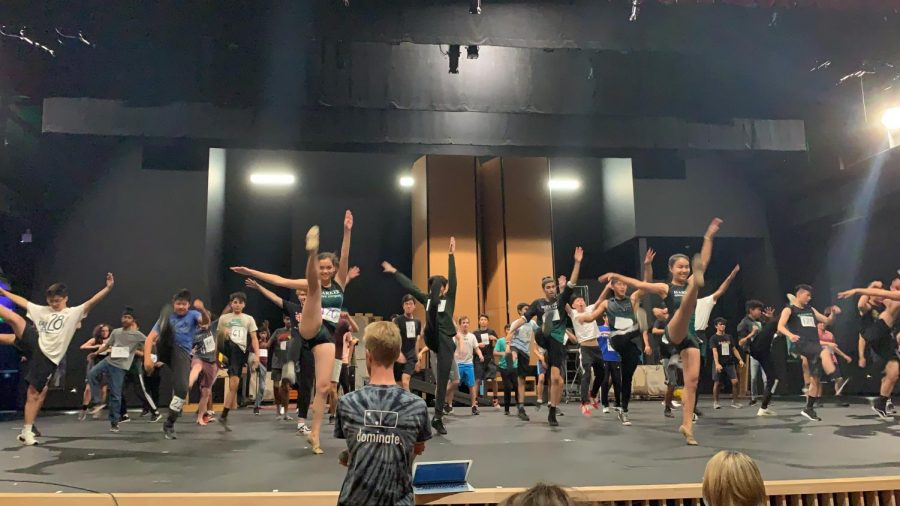 Upper school dance teacher Karl Kuehn looks on as students audition for the annual dance production. Auditions took place on Sept. 14.