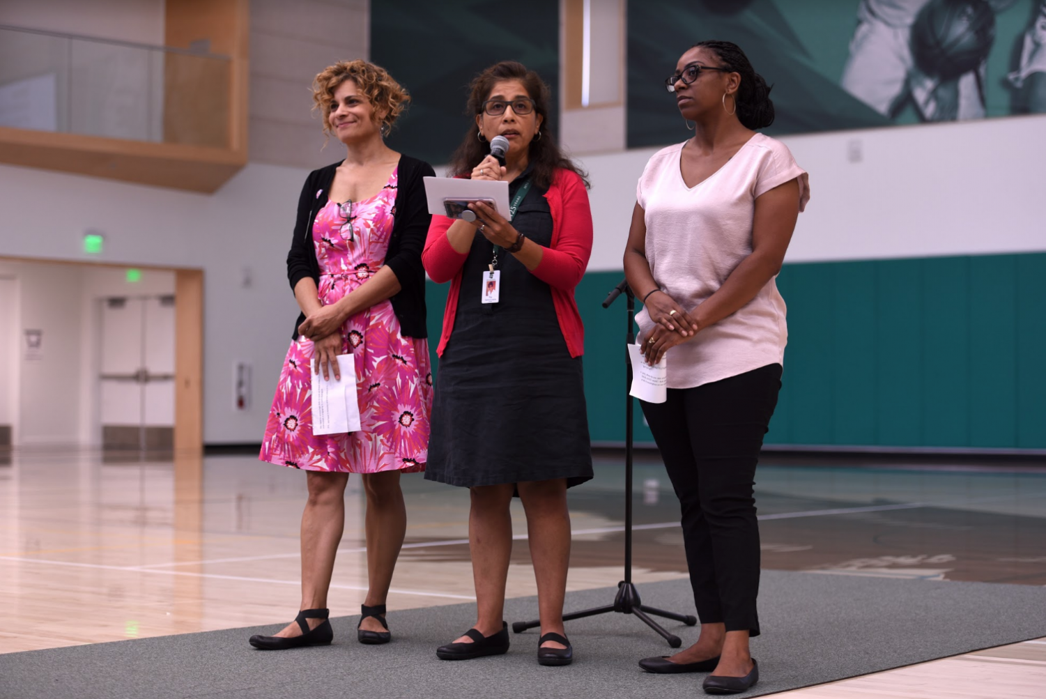 Diversity Committee faculty members Dr. Lola Muldrew, Pilar Aguero-Esparza and Tyeshia Brown speak to the upper school community about an upcoming assembly featuring Jay Smooth, a cultural commentator. To introduce Smooth, Diversity Committee played his YouTube video about race at school meeting yesterday.