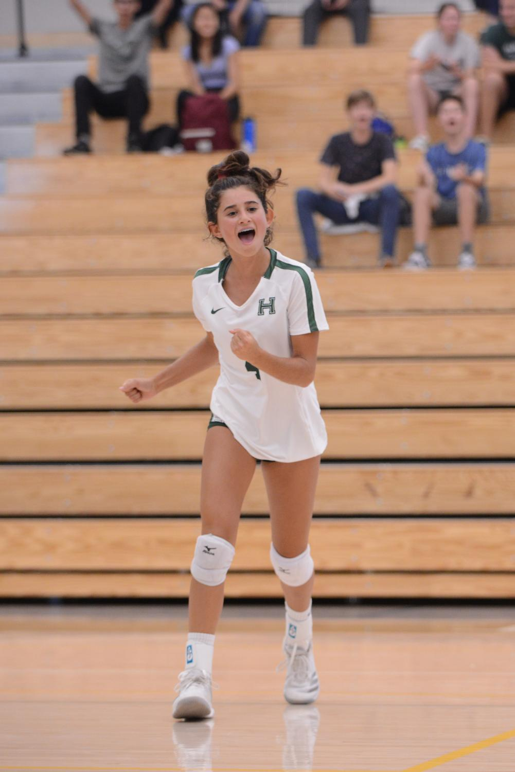 Tara+Ozdemir+%2810%29+celebrates+after+a+point+during+the+varsity+girls+volleyball+match+against+Branham.+The+Eagles+won++25-16%2C+25-18%2C+25-15.