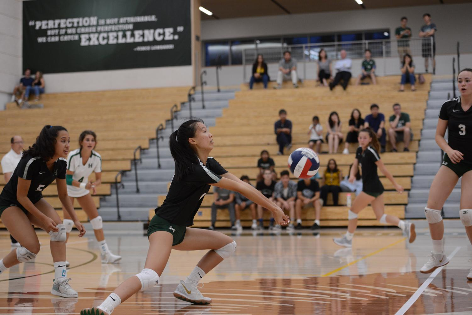 Carolyn+Lu+%2812%29+lunges+forward+to+pass+the+ball+in+the+girl%27s+varsity+volleyball+team%27s+home+game+against+Westmont.+The+Eagles+won+the+match+25-20%2C+24-26%2C+25-19%2C+25-16.+