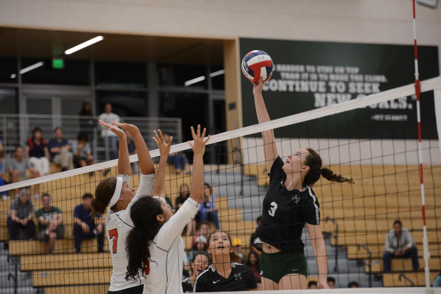 Lauren+Beede+%2812%29+jumps+up+to+tip+the+ball+over+the+Westmont+block.The+junior+varsity+team+also+competed+in+the+Spikefest+Tournament+at+Independence+High+School+on+Sept.+7%2C+defeating+Homestead%2C+Presentation+and+Menlo+before+losing+to+Notre-Dame+Belmont+in+the+semifinals+and+earning+third+place+overall.