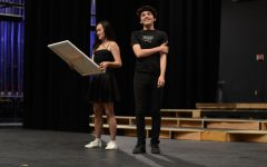 Katelyn Chen (12) and Joel Morel (12) act out a scene from