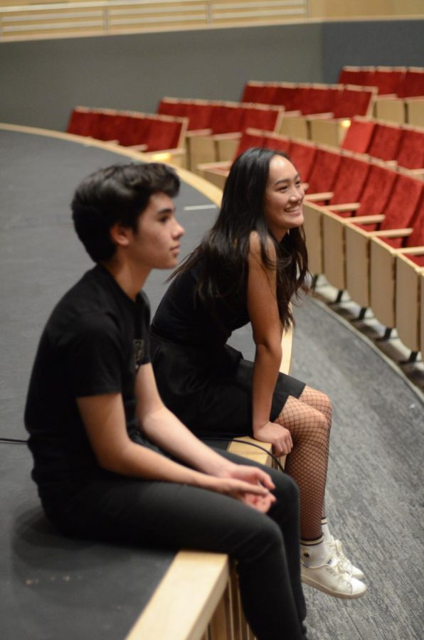 Katelyn Chen (12) and Joel Morel (12) listen to feedback from director Jeffrey Draper after rehearsing their scene.