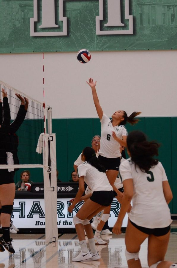 During the game against Mercy San Francisco on Sept. 10, setter Emily Cheng (12) tips the ball over the net as her teammates watch on. The varsity, junior varsity and freshman teams all defeated Mercy, winning every set.