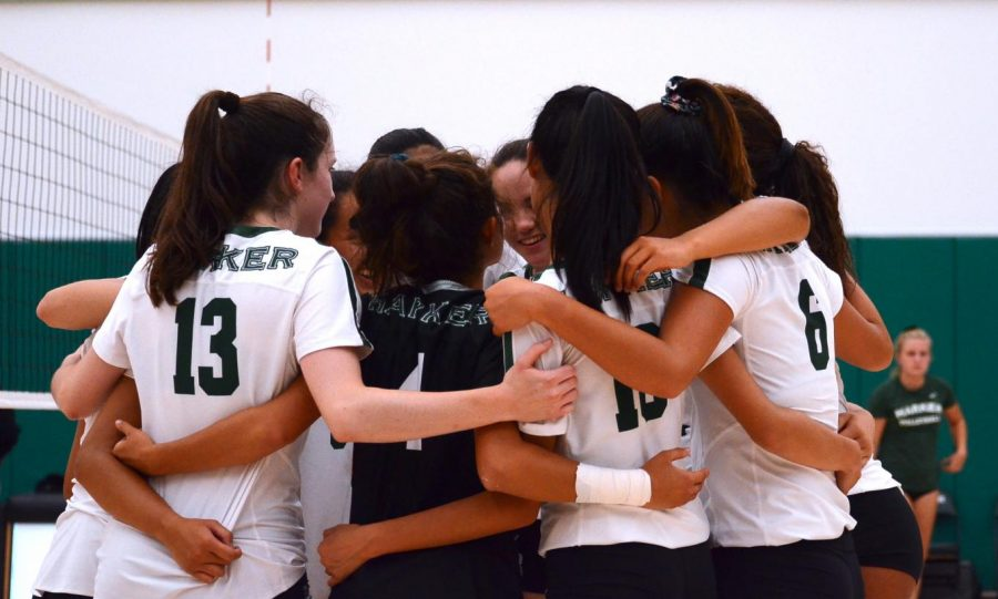 The varsity girls volleyball team huddles during a win against Mercy High School, San Francisco. At Dig Pink tomorrow, the freshman team will play Mercy High School Burlingame at 4 p.m., junior varsity at 5:30 p.m. and varsity at 6:30 p.m.
