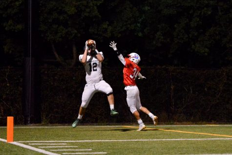 Marcus Anderson (11) catches a touchdown pass in the endzone.