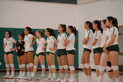 The+varsity+girls+line+up+at+the+baseline+prior+to+their+match+against+the+Mercy-Burlingame+Crusaders.+