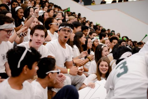 Rosh Roy (11) cheers for the Class of 2021 at the annual homecoming spirit rally on Oct. 11. The rally featured a series of events that invited the four classes to compete for spirit points, such as a lip sync competition and a relay race.