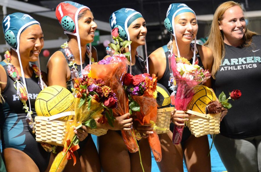 Seniors+Alicia+Xu%2C+Arushi+Madan%2C+Cassandra+Ruedy+and+Anika+Tiwari+pose+with+head+coach+Allie+Lamb%2C+holding+bouquets+and+signed+water+polo+balls.+