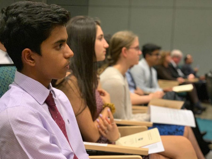 Dhruv+Saoji+%2810%29+listens+as+upper+school+head+Butch+Keller+delivers+a+speech+to+the+newly-inducted+NHS+members.
