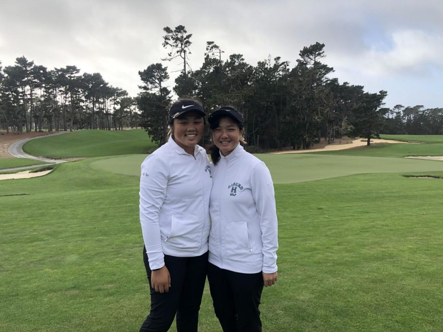 Golfers Natalie Vo (11) and Claire Chen (9) pose together during the state championships on Nov. 19. Claire tied for third place in the tournament, earning a final score of 73, two strokes over par.