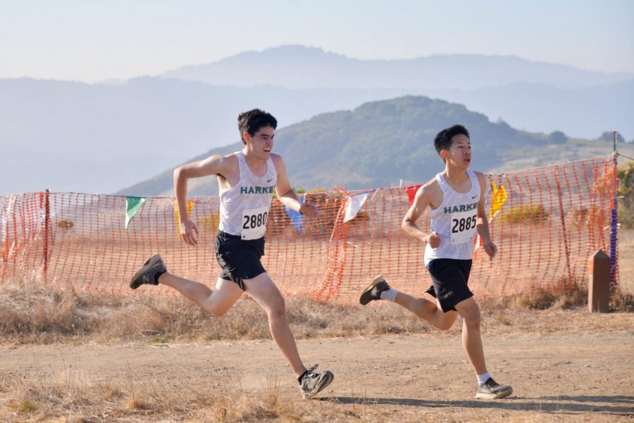 Grant Miner (12) and Richard Zhang (9) sprint down the final stretch of their junior varsity boys race at Crystal Springs.