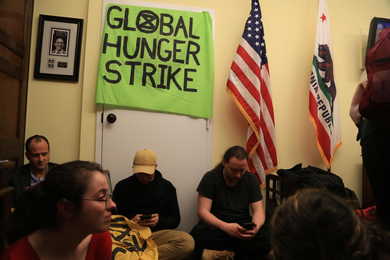 Hunger strikers gather in the Longworth office of Speaker of the House Nancy Pelosi (D-CA) in the Capitol on Wednesday.  The strikers had been in Pelosi's office for three days as a part of the global environmental movement Extinction Rebellion.