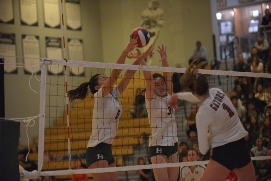 Lauren+Beede+%2812%29+and+Emily+Cheng+%2812%29+attempt+to+block+a+hit+from+a+Sacred+Heart+Prep+player.