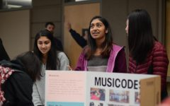 Vaishnavi Murari (11) talks about service opportunities at the intersection of music and computer science as a student representative for the volunteer organization MusiCodes, along with the co-founders Michelle Si (11) and Aarzu Gupta (12), at the annual service fair. The service fair featured booths from 28 volunteer organizations in the Nichols Auditorium on Oct. 30.