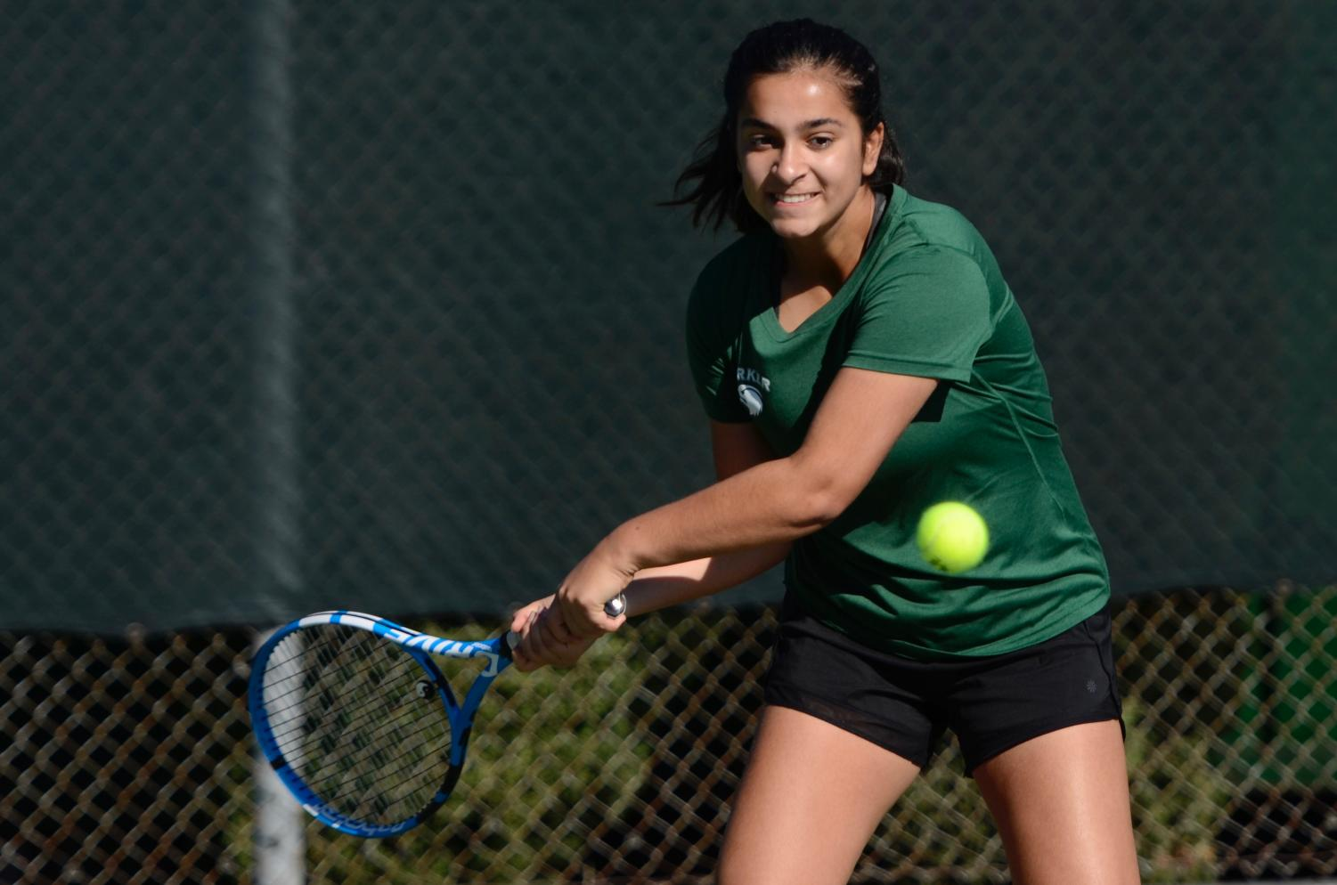 Anushka Mehrotra (9) prepares to hit the ball during her singles match in CCS semifinals. After an impressive performance this season, the girls tennis team lost to St. Francis High School 5-2 on Saturday, Nov. 16