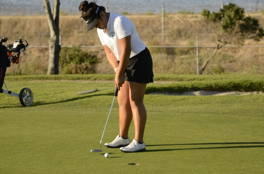 Natalie Vo (11) putts during the girls' matchup against Castilleja on Oct. 7.  Natalie and Claire Chen (9) qualified for the State Championship as individuals.