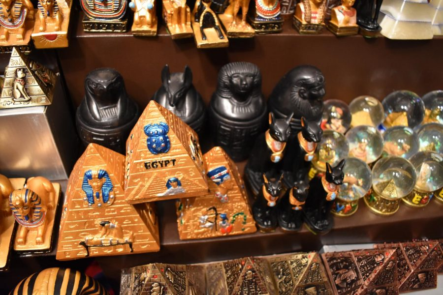 """Handmade merchandise from Egypt adorn the shelves of a booth at the Holiday Market. """"You have a lot of local artists who will come and display their artwork, their crafts, and it's a very good place to see all that in one place,"""" Maryland resident Maile Kahara said."""