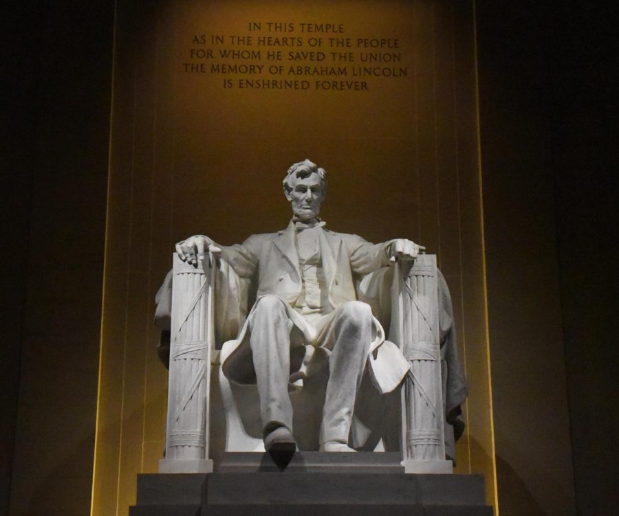 Lincoln Memorial. This statue of the late President Abraham Lincoln stands to honor him with a replica of him sitting on the chair where he was assassinated.