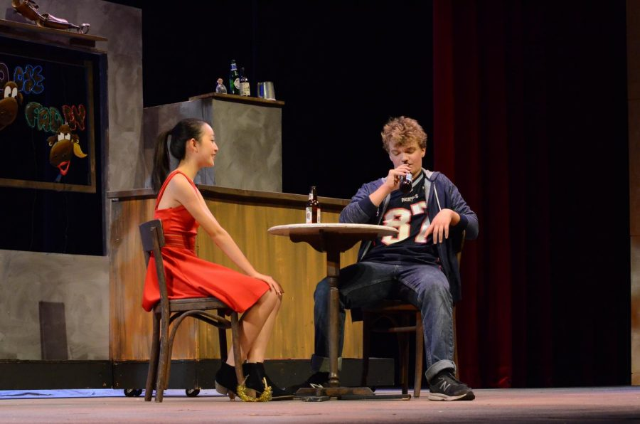 Arely Sun (10), playing Sandrine, and Evan Bourke (11), playing Jimmy, sit together at a table during