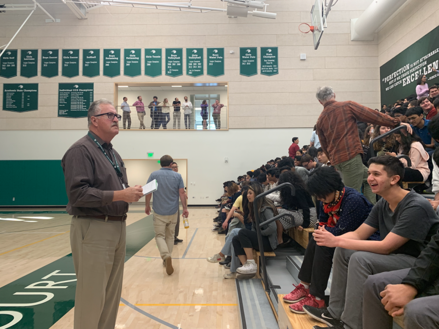 Assistant Head of Student Affairs Greg Lawson takes roll for his advisory at the all-school meeting today. Administrators called this meeting, which was at 2:45 p.m., in response to reports of a threatening graffiti message in the downstairs Dobbins boys bathroom.