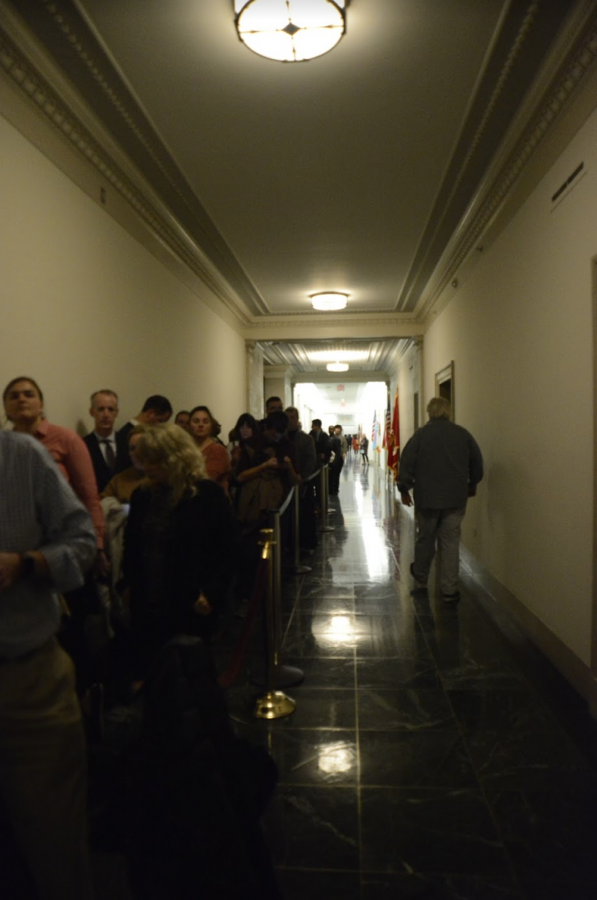 The line to witness the impeachment hearing spreads down the dimly lit hallway. People who waited could only enter if another person exited the room.