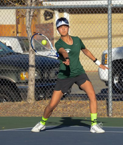 Varsity tennis captain Gina Partridge (12) hits the ball during a team practice earlier in the season. After beating Menlo-Atherton 4-3 in the CCS quarterfinals match, they move on to semifinals on Saturday, Nov. 16, against St. Francis.