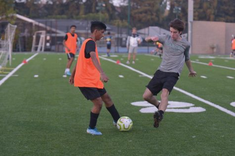 Senior Asmit Kumar evades a steal attempt by Ryan Tobin (11) during  practice. There are three boys soccer teams this year.