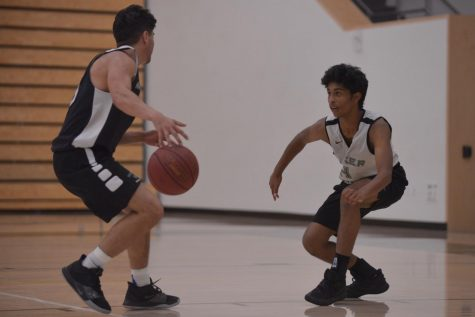 Co-captain Giovanni Rofa (12) brings the ball up the court, closely guarded by Srivishnu Pyda (11) during practice on Nov. 8. This week, the Eagles competed at the 58th Annual James Lick Invitational Tournament (JLIT) from Dec. 4 to 6, going 1-2 with narrow defeats of 48-45 and 52-48 to American High School and Fremont High School respectively, but a decisive 52-27 win against James Lick High School.