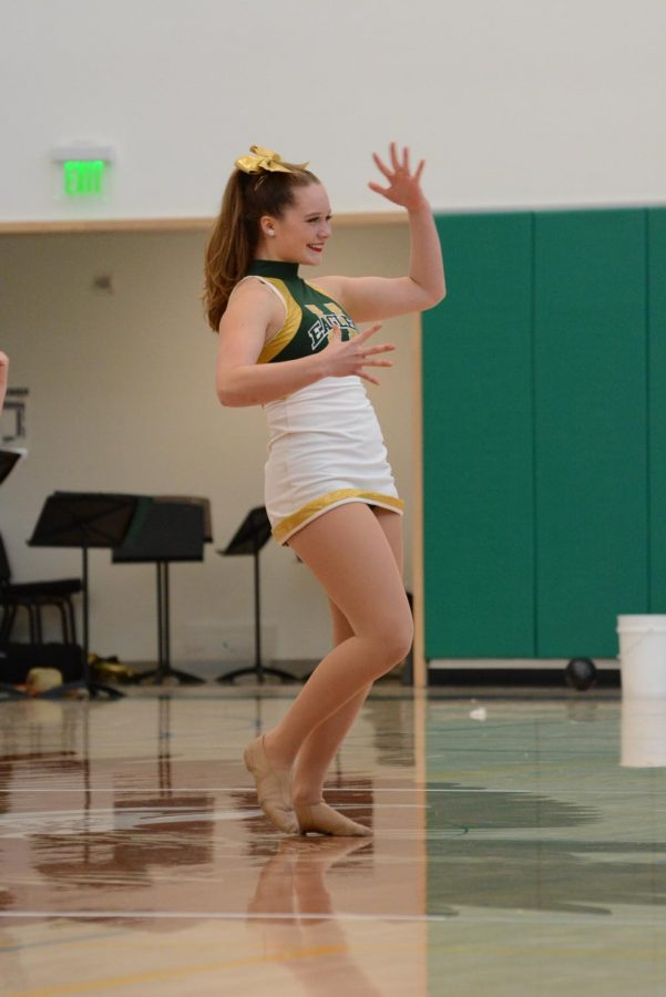 Charlotte Blanc (12) performs during the Homecoming rally. Both varsity and junior varsity dance teams joined this year to form the Harker Dance Company.