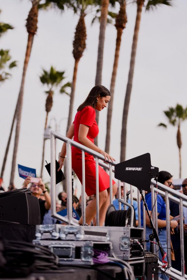 Rep.+Alexandria+Ocasio-Cortez+descends+from+the+stage+after+introducing+Democratic+presidential+candidate+Sen.+Bernie+Sanders+at+his+campaign+rally+in+Venice+Beach+last+Saturday.+At+this+rally%2C+Ocasio-Cortez+declared+her+endorsement+of+Sanders%27+campaign.