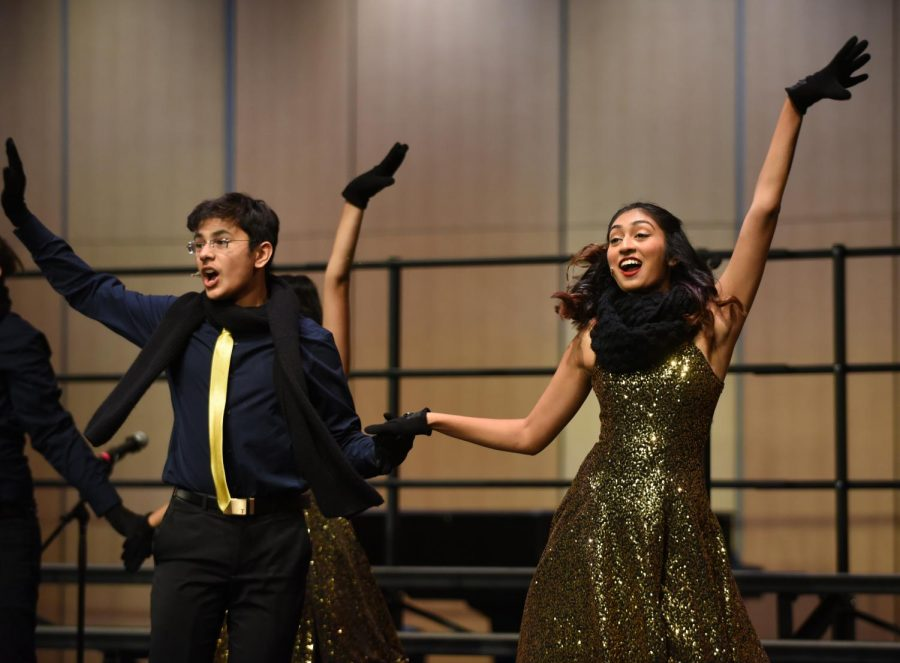 Downbeat singers Vaishnavi Murari (11) and Shray Alag (11) dance together in a rendition of