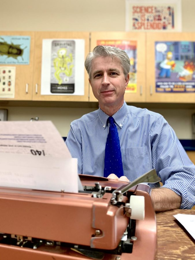 Biology teacher Thomas Artiss, at a thrifted typewriter that he brought to his classroom for students to experiment with. In his Heart of Harker guest column, Artiss responds to the newly popularized phrase