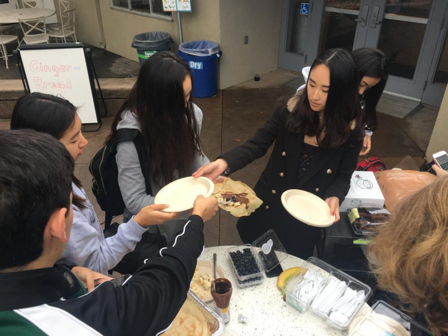 Members of the French National Honor Society (FNHS) make crepes and sell a variety of French goods to students after school. FNHS joined the Chinese and Japanese National Honor Societies in hosting club week during the week. of Dec. 2, selling food and drinks during lunch and after school to raise funds for Doctors Without Borders.