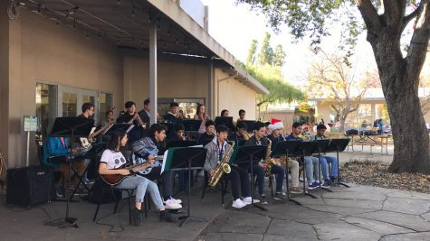 "Jazz band performs Christmas songs outside the auxiliary gym today during lunch. Some of their songs included Christmas classics ""Winter Wonderland"" and ""Santa Claus is Coming to Town."""