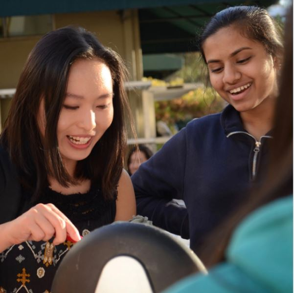WiSTEM treasurer Catherine Zhao (12) spoons boba into a cup as she prepares a drink at the club's fundraiser, which funds the organization WISER. In addition to selling baked goods and tea, they also organized a movie screening.