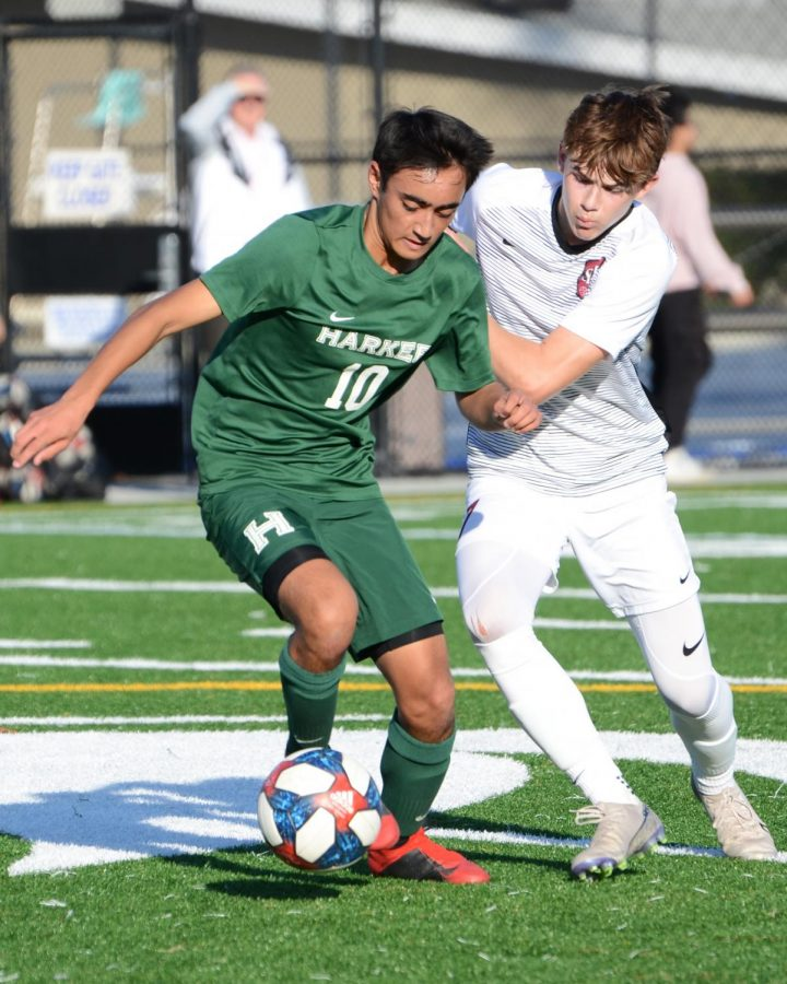 Darshan Chahal (12) dribbles downfield during the Eagles' 3-3 tie against undefeated Sacred Heart last Wednesday. The boys are currently 4-1-1 in league.