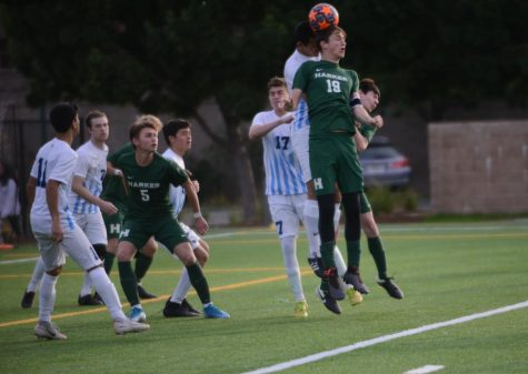 Andrew Cheplyansky (12) controls the ball with a header during the varsity game against Leland last Wednesday. The varsity team will play Crystal Springs in an away conference game this Wednesday at 3:30 p.m.