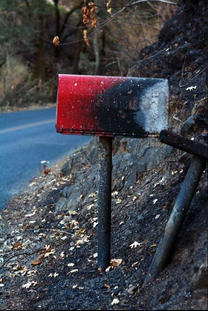 A mailbox on Chalk Hill Road bears the Kincade fire's mark. After firefighters fully contained the fire on Nov. 3, Cal Fire lifted all evacuation orders.