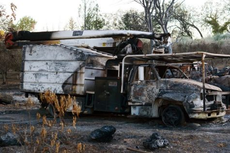 A scorched car sits parked on the side of Chalk Hill Road in Healdsburg, Sonoma County. The Kincade wildfire threatened 90,000 structures at its peak.