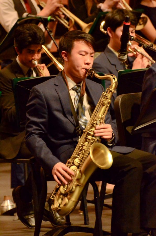 Tenor saxophonist Brendan Wong (12) plays with the rest of jazz band in one of their pieces from their repertoire, which they built up over the course of first semester.