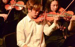"Senior violin soloist Hanoom Lee leads the orchestra in Pablo de Sarasate's ""Zigeunerweisen"