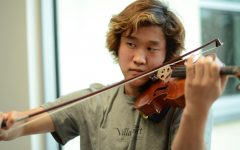 """[Climbing and violin] both use a lot of muscle memory, and in that way it kind of translates. Even if it's scary, the moves you make while climbing and playing can be classified as very elegant. I think focusing on each and every move makes it very peaceful,"" Hanoom Lee (12) said."