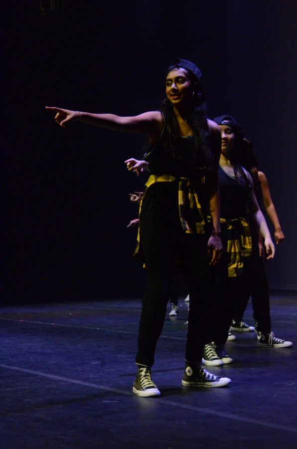 A dancer points during her routine. The week before the show, students attended three hour rehearsals to prepare for the show.