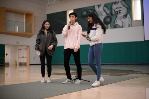 TALON yearbook editors-in-chief Emily Chen (12) and Anthony Xu (12) and TALON managing editor Shreya Srinivasan (11) announce that all yearbooks from this year onwards will be free to all students and faculty at school meeting last Friday.