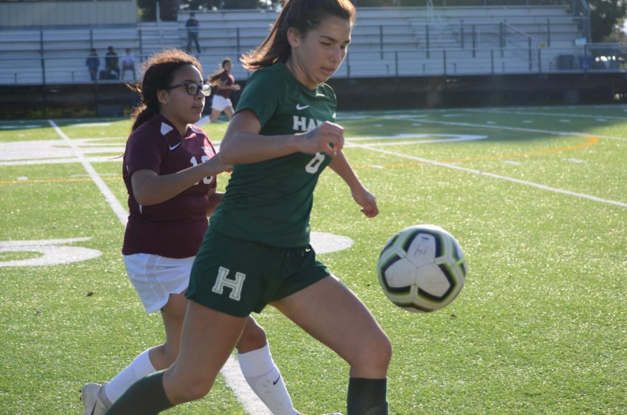 Varsity co-captain Emma Boyce prepares to kick the ball down the field during the girls' game against Eastside. Emma, Cassie May (9), Lexi Wong (9) and Megha Salvi (10) all scored goals during the match.